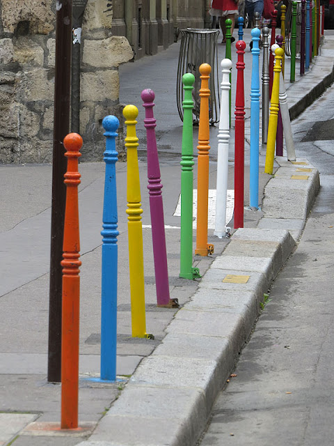 Multi-colored street poles, rue Charlemagne, Paris
