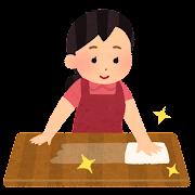 机を拭く女性のイラスト(掃除)