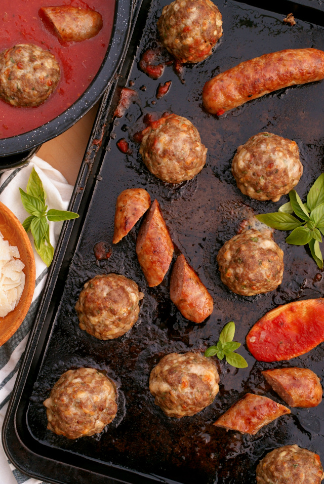 Sheet Pan Meatballs and Sausage that are perfectly cooked in the oven can be simmered in pasta sauce, served on crusty rolls as subs, or frozen for quick and easy meals later.  You will love this recipe!