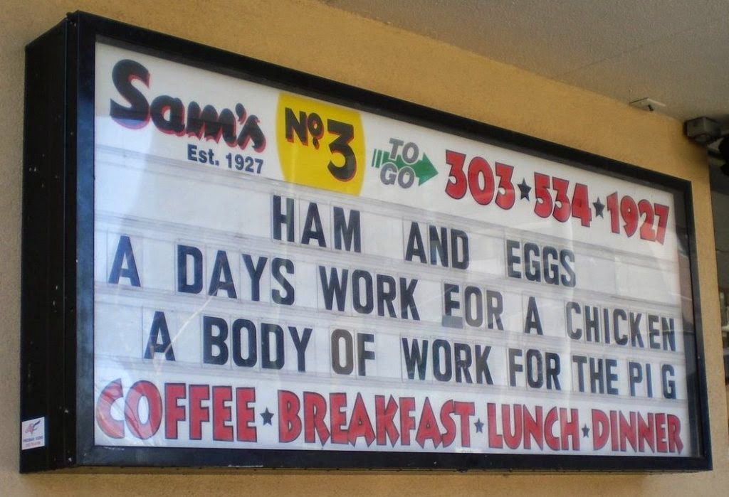 Ham and Eggs - A days work for a chicken. A body of work for the pig. Sign spotted at Sam's Diner No. 3 in Denver in 2009