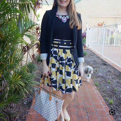 awayfromblue instagram summer officewear business casual mustard pleated skirt black blazer LV nervfull tote
