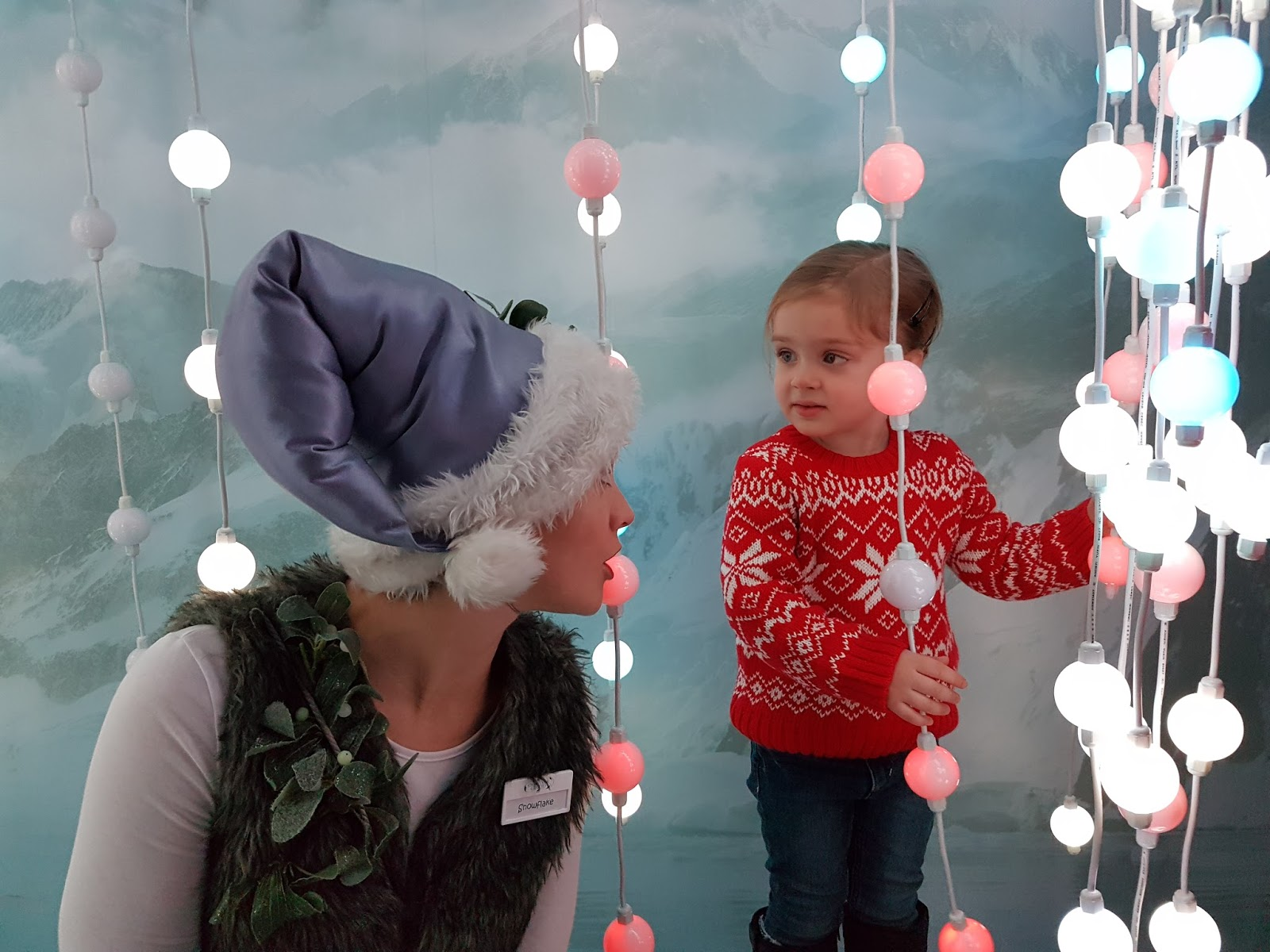 girl chatting with elf at harrods christmas grotto 2016