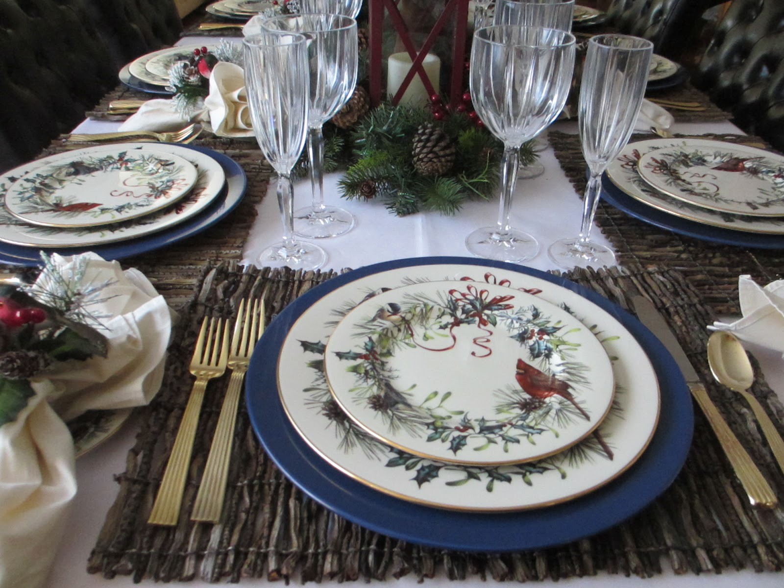 The welcomed guest lenox winter greetings tablescape the plates feature a cardinal and a chickadee among the pine and holly m4hsunfo