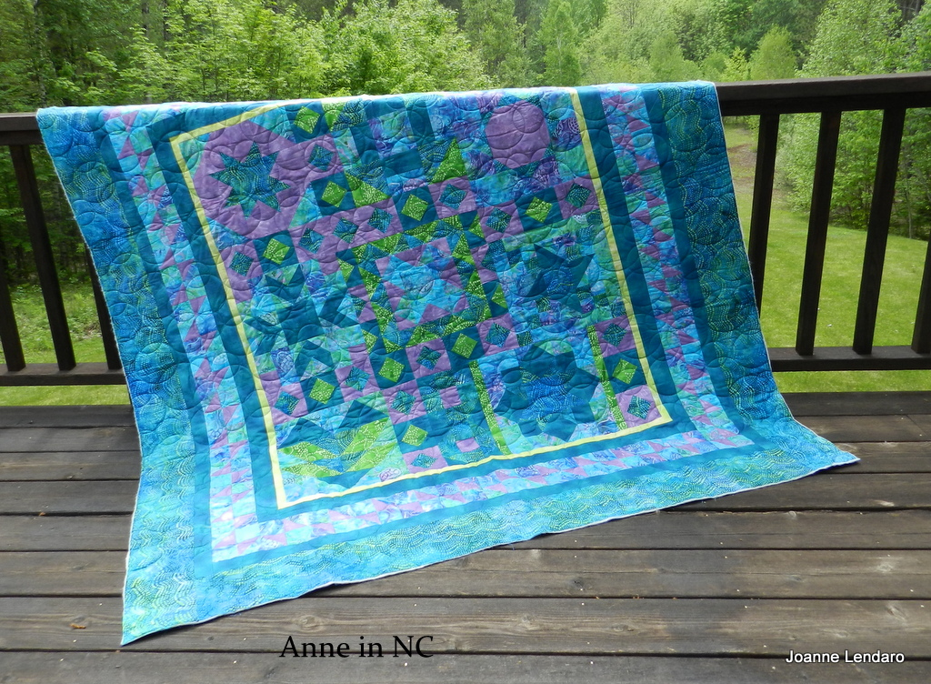 Beautiful This beautiful blue green quilt came from Anne in NC She made this quilt for her daughter who loves the ocean We decided that Bubbles from Anne Bright