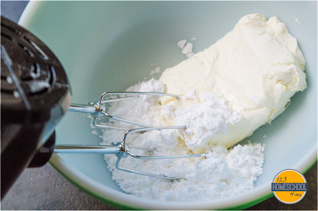 cream together cream cheese and powdered sugar