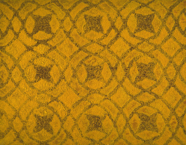 Indian pattern painted in turmeric and cloves