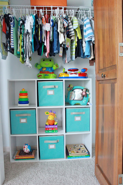 Love this cubby and bin ideas for a baby's closet from http://www.delightfullynotedblog.com