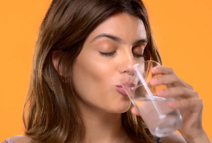 Woman drinking salty water