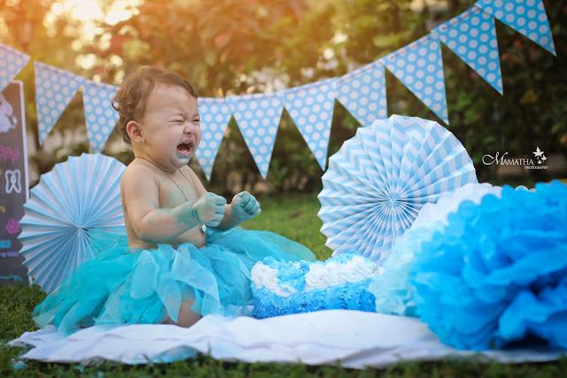 Baby smashing the cake on her 1st birthday