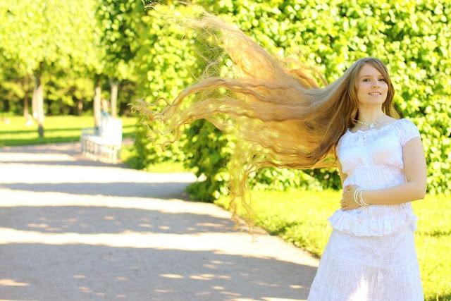 girl flying long blond hair