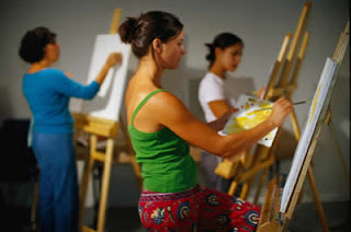 Art class with several artists painting at their easels.