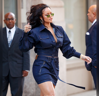 Rihanna rocks head to toe denim and flaunts her cleavage