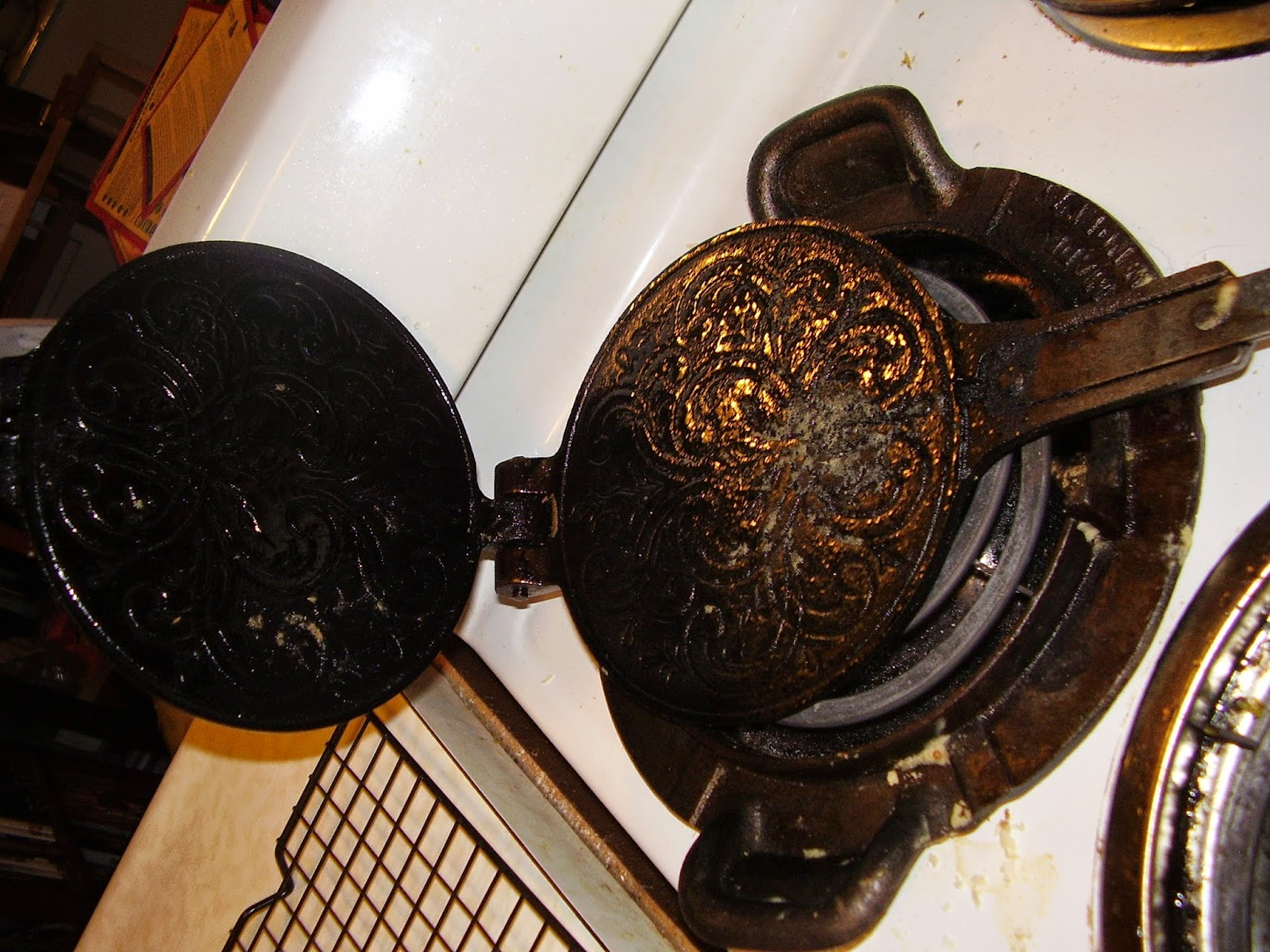 Krumkake iron on stove.