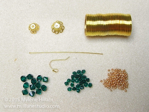 Bicone crystals, seed beads, and jewellery making supplies required to make the Emerald Bauble earrings