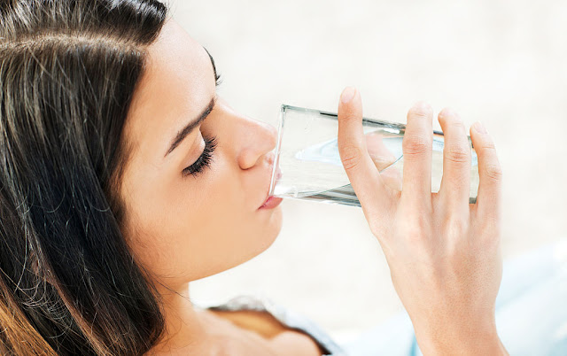a beautiful lady is drinking water