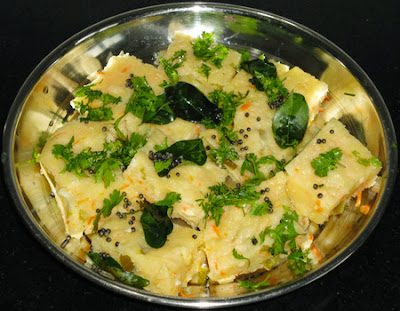 temper the dhokla and garnish with cilantro