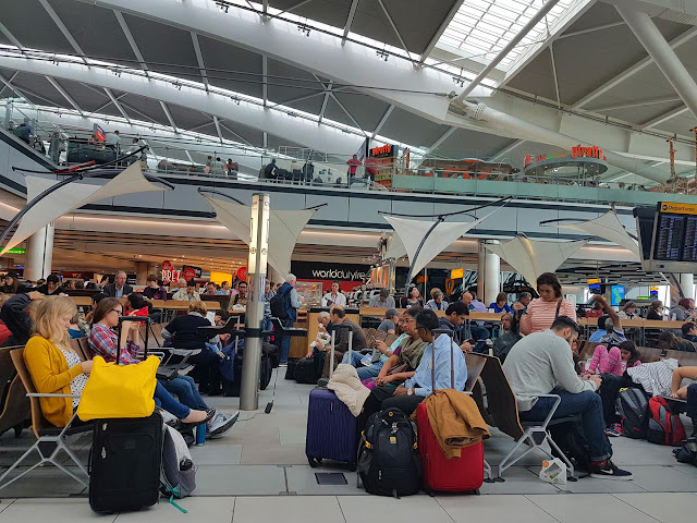busy terminal at heathrow airport