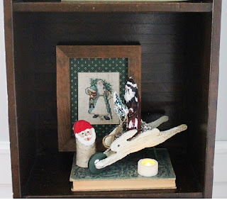 decorated holiday bookshelf 4