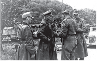 The moment at which General Otto Fretter-Pico (second left) formally surrendered to Brazilian forces in Fornovo di Taro