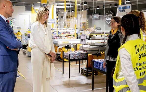 Queen Maxima wore Massimo Dutti ivory silk blouse with bow and trousers, Cartier Gold Bamboo earrings