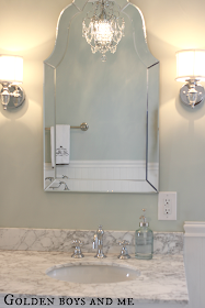 Master Bath with carrera, waterton sconce, chandelier, lowes arch frameless mirror - www.goldenboysandme.com