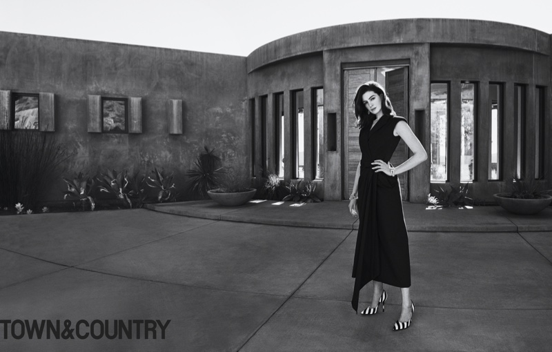 Anne Hathaway poses in Dries Van Noten dress and heels