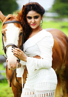 Sony Chatista Rides Horse in Sexy Cleavage Exposing Ass Shape enhancing and Navel Exposing Tight White Dress