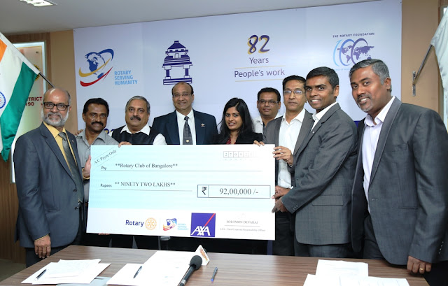 Solomon Devaraj, Chief Corporate Responsibility officer (India), AXA Business Services handing over the cheque to RCB