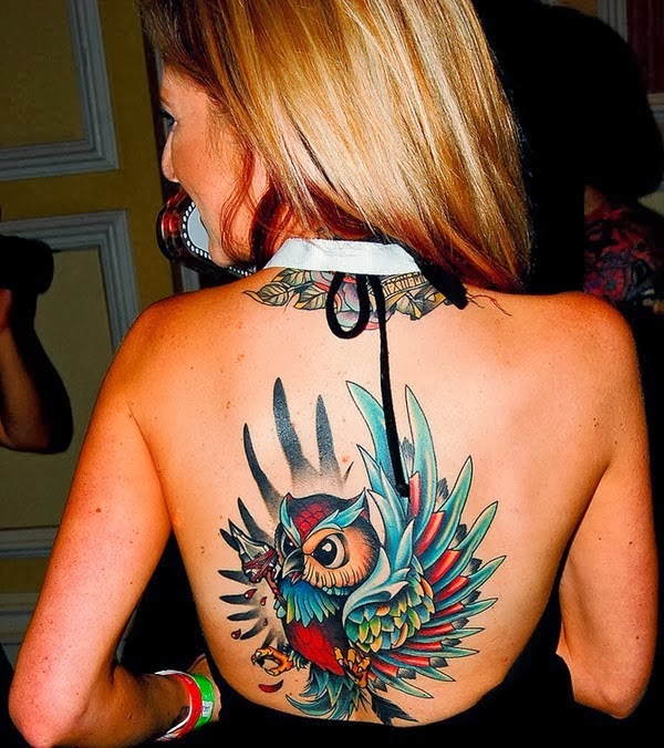 Owl back tattoo for girls, amazing colors.