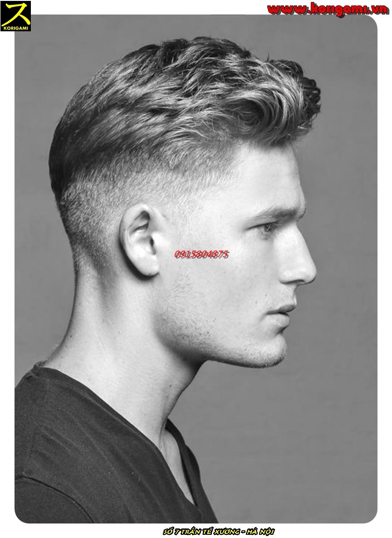razor faded pompadour haircut for men in hanoi barber shop