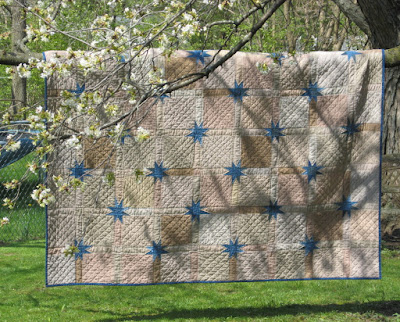 Scrappy quilt with Uneven Stars or Morning Stars or stars in the sashing