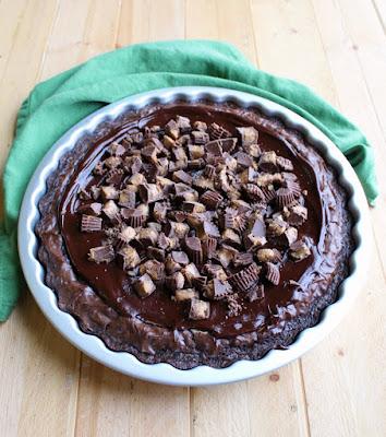 full peanut butter cheesecake brownies in tart pan