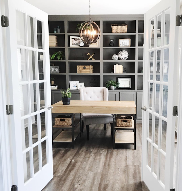 gray built in bookshelves in office