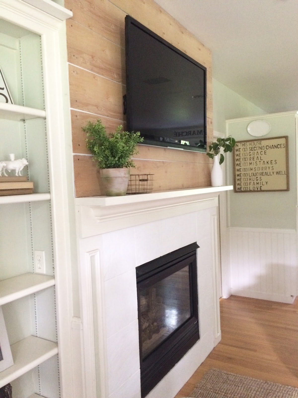 little farmstead farmhouse style shiplap above the fireplace