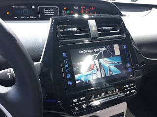 Pic on computer alongside stearing wheel inside Toyota Prius