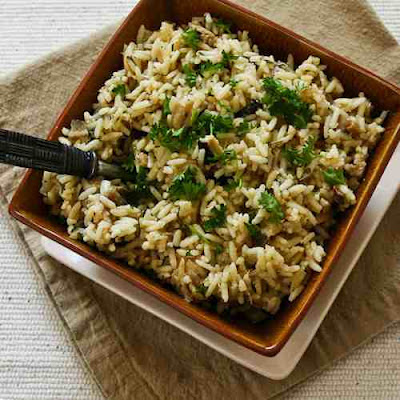Slow-Cooker Rice with Dried Mushrooms, Herbs, and Parmesan