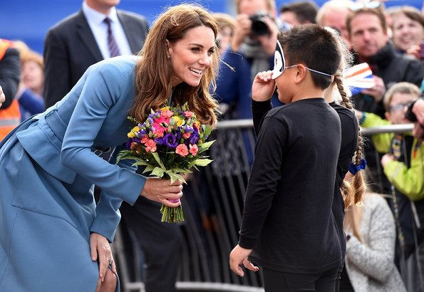 Kate Middleton wore a cornflower blue coat by Alexander McQueen. Emmy London Josie shoes Mappin and Webb empress drop earrings