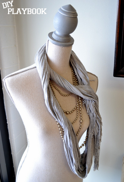 Loved this mannequin bust adorned with a scarf and golden pearl jewelry