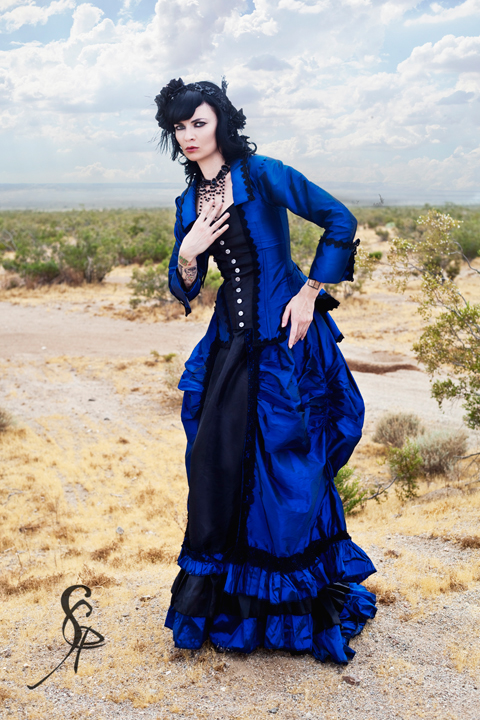 woman wearing blue and black victorian era dress (skirt and bodice) with a gothic victorian syle - women's gothic victorian and steampunk clothing and costumes
