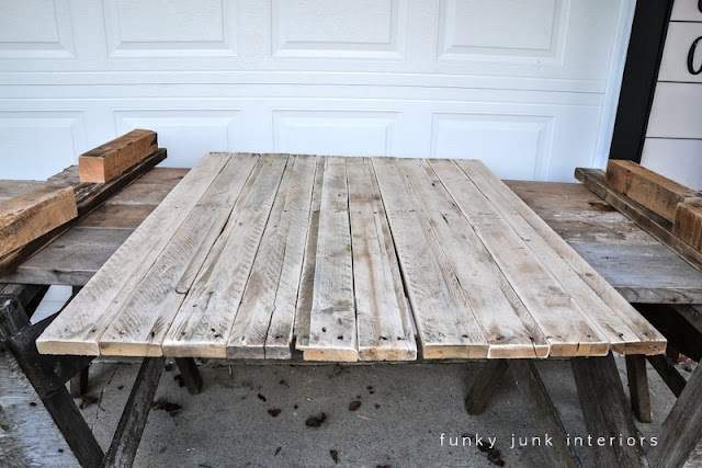 Learn how to build a rustic pallet wood coffee table from scratch! And decorate it well with plenty of cool vintage rusty junk!