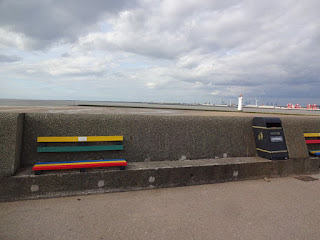 The benches put in by the Wirral Older Peoples Parliament fit perfectly in the space on the sea wall. As do the litter bins