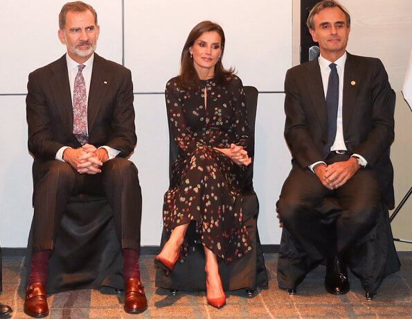 Queen Letizia wore Massimo Dutti confetti-print shirt-dress and Carolina Herrera silk blouse from spring 2017 collection