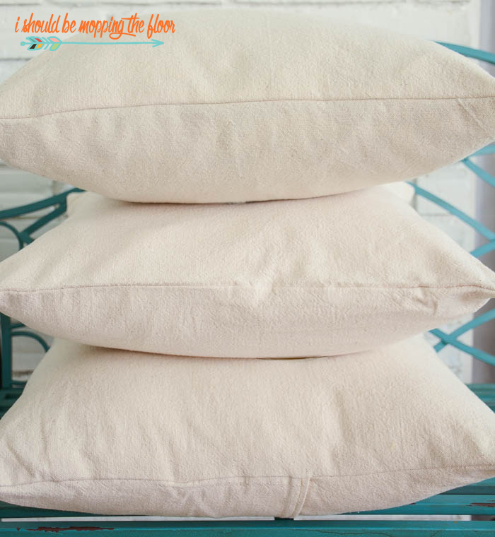 Easy Envelope Pillow Covers | Make a super budget-friendly envelope pillow cover out of a drop cloth or fabric! Perfect for a beginner sewing project.