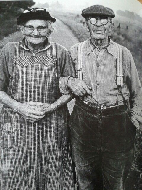 Old black and white photo of a senior couple in work clothes pose with arms linked. Speak Your Mind and other stories of Grandmas and reason. marchmatron.com