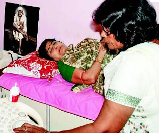 Kanakalata Ram having an ultrasound