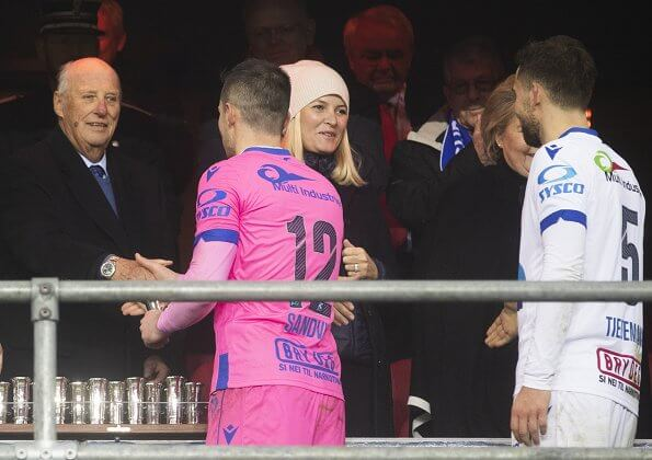 King Harald, Crown Princess Mette-Marit and Prime Minister Erna Solberg attend the cup final between Haugesund and Viking