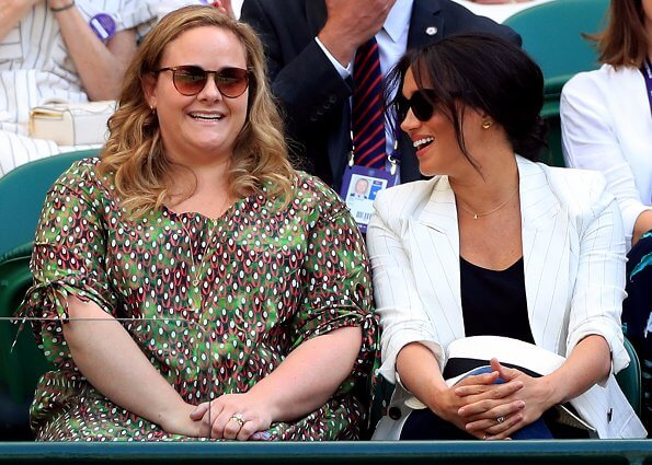 Meghan Markle wore L'Agence Brea pinstriped-linen and cotton blend blazer. The Duchess of Sussex and Serena Williams