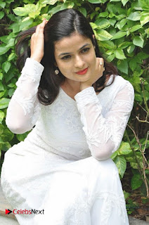 Actress Dolly Tomar Pictures in White Salwar Kameez at Deccan Film Society Launch  0014