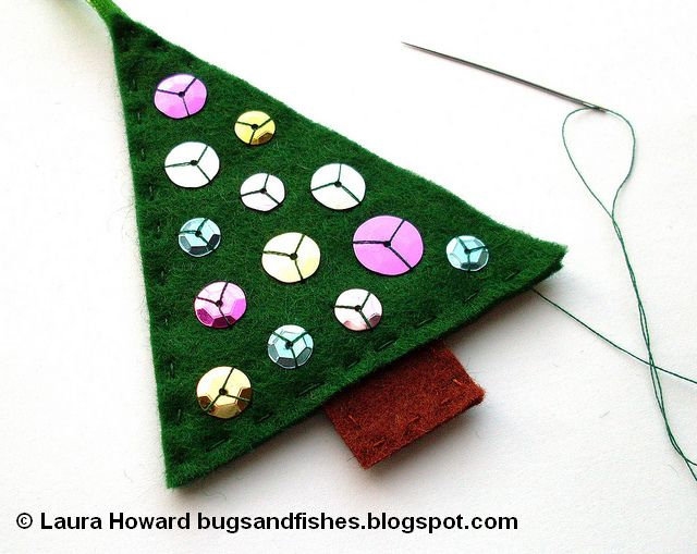finishing sewing a felt Christmas tree decoration