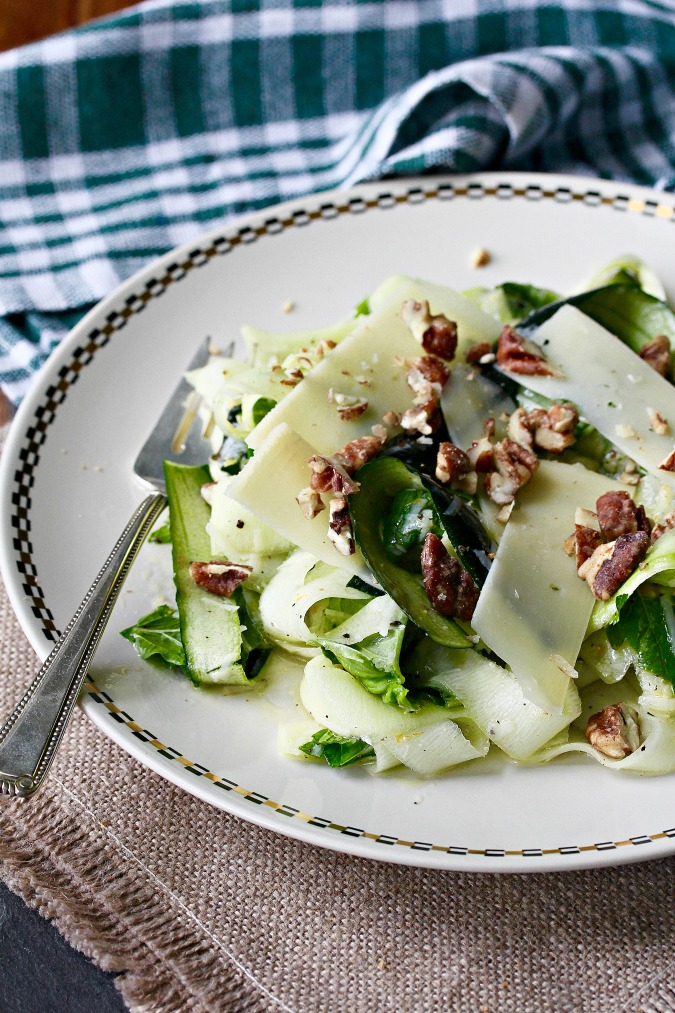 This Zucchini Parmesan Salad is an wonderful combination of raw zucchini topped with shaved Parmesan and candied pecans, and dressed with a bright lemon dressing.
